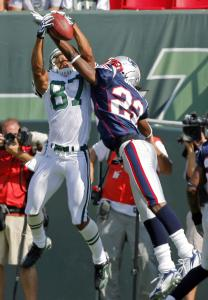 Despite Asante Samuel's efforts, Jets receiver Laveranues Coles corraled this touchdown pass.