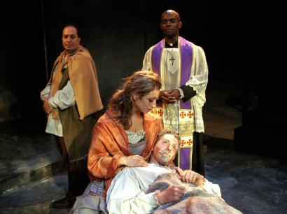 Caroline deLima holds Christopher Chew in the Lyric Stage's production of 'Man of La Mancha.' At rear (from left) are Robert Saoud and Kenneth Harmon.