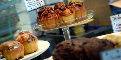 Display cases at the Spotted Apron show off some of the many delicious pastries and baked goods.
