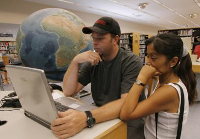 Chris Pore and Dora Castillo surfed the Internet recently using the free wireless service at this Las Vegas library.