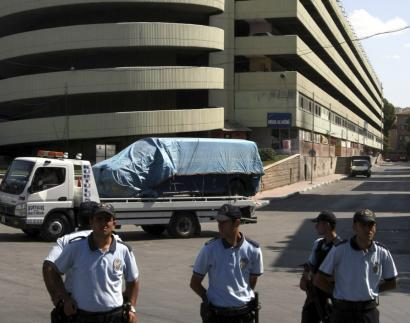 A van with explosives, detected by a bomb-sniffing dog, was trucked away yesterday from a parking garage in Ankara. Nearby buildings were emptied and cellphones in the area disabled.