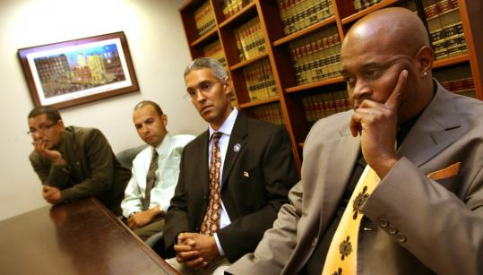 Police officers who filed a federal civil rights lawsuit include (from left) Pedro Lopez, Charles DeJesus, Abel Cano, and Kevin Sledge. Richard Brooks was not available.