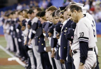 Joe Torre joins firefighters from New York and Toronto in ceremonies marking Sept. 11.