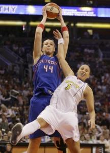 At 6 feet 8 inches, Katie Feenstra didn't need much to keep a rebound away from Phoenix's Diana Taurasi.