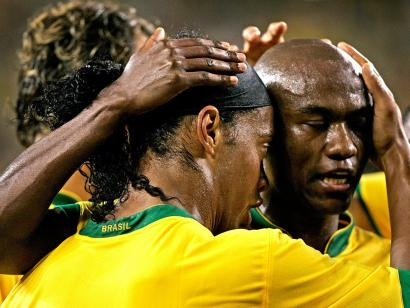 Brazil's Ronaldinho congratulates Kleber after his first-half goal tied the match with Mexico.