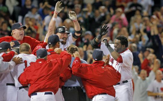 . . . and after it did, the celebration was on in earnest for his decisive two-run home run, which lifted the Red Sox to a 5-4 victory last night.