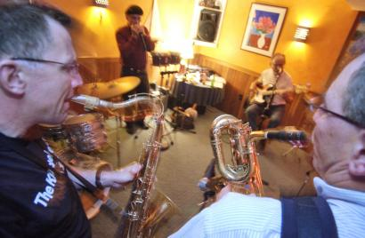 Four of the Knuckleheads, (from left) Pete McCormack, Domingo Rosa, Tom Doran, and Howard Rubenstein, rehearse in the soundproof basement of another member, Tim McHale, in Allston.
