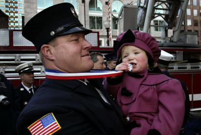 Lowell firefighter Kelly Page, who was given the Medal Of Valor, shared his award outside Faneuil Hall in 2003 with daughter Keara.