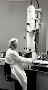 Elizabeth Hay with an electron microscope.