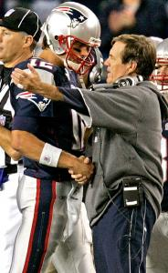 Their work done and the win long ago secured, Tom Brady and Bill Belichick share a subdued handshake on the sideline.