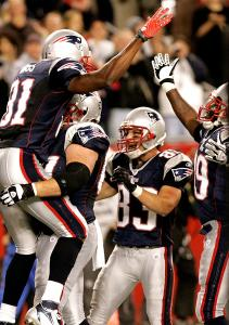 Randy Moss (81) is party to an end zone celebration with his teammates after the first of his two touchdown catches.
