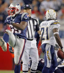 Linebacker Rosevelt Colvin does a little high-stepping after putting the brakes on LaDainian Tomlinson.