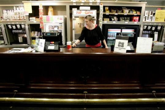 Charis Tarbett works the unusual concession stand that's an antique bar with brass foot railing.