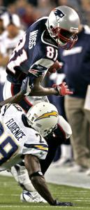 With the Chargers' Drayton Florence down and out, Randy Moss takes one of his eight catches up the sideline Sunday.