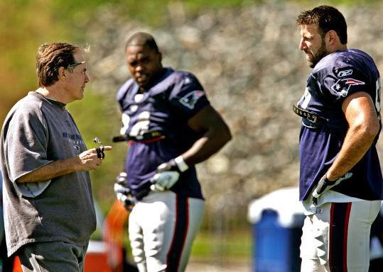 Mike Vrabel (right) is happy Bill Belichick (left) switched him back to his natural position.