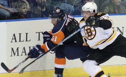 Martins Karsums of the Bruins sticks close to the Islanders' Frans Nielsen on Tuesday.