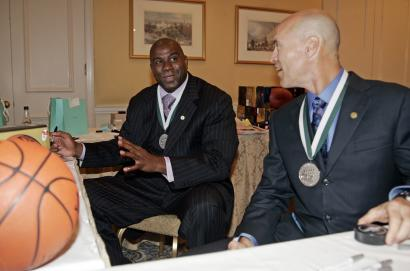 Former basketball star Earvin 'Magic' Johnson (left, with former hockey player Mark Messier in New York) will be in Charlestown today to promote a condo project he is developing. The prospect of casinos in the state has his attention as well.