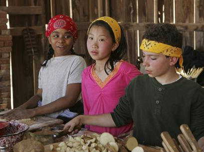Divad, Kelsey, and Zach cook up a meal on 'Kid Nation,' the new CBS reality series.