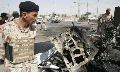 Iraqi soldiers inspected the wreckage of a vehicle used in a car bombing yesterday in Baghdad. The attack killed three people. Such attacks have fallen to their lowest levels in a year, and civilian casualties have dropped from a high of about 32 to 12 per day.