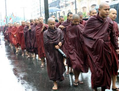 Monks marched down a street in Rangoon, Burma, yesterday. The protest against the ruling junta lasted more than three hours. The government handled the situation gingerly, aware that restraining or abusing monks could spark public outrage.