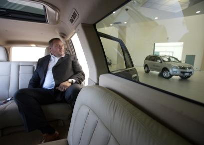 Dealer Carlo Scalvini in a stretch limo model of the Hover, a car imported from China in a showroom in Palazzolo Sull'oglio, Italy. China's inroads into Europe are the first test of the world's richest markets by Chinese automakers.