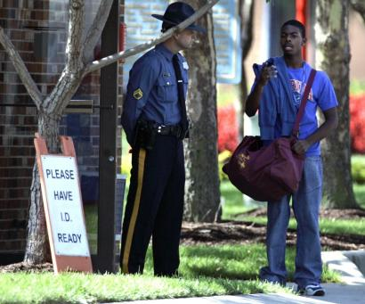 Delaware State University student Devin Jackson talked with a police officer on campus yesterday after the shootings.