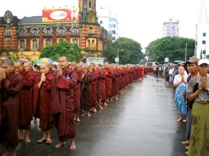 Buddhist monks were allowed to march to the home of detained opposition leader Aung San Suu Kyi as street protests against the ruling military junta intensified yesterday in Rangoon and in other parts of the country.
