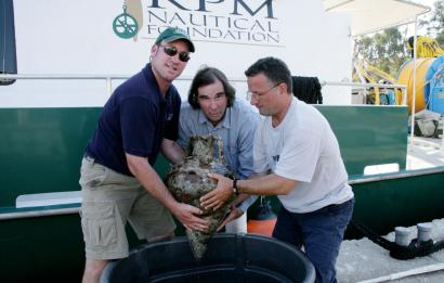 From left, dive master Howard K. Phoenix and archeologists George Robb and Adrian Anastasi held a Greek jar from what organizers say is the first detailed survey of Albania's seabed.