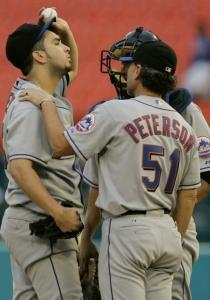 Pitching coach Rick Peterson calms the Mets' Oliver Perez in the eighth. Perez earned his 15th victory.