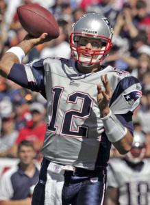 Tom Brady completed passes to eight receivers and threw for 311 yards and four touchdowns. He has 10 TDs and one interception this season.