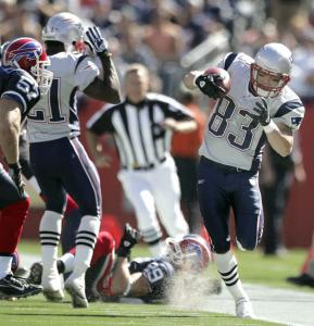New England's Wes Welker steps out of bounds as he tiptoes down the sideline returning a Brian Moorman punt 26 yards. Welker returned three punts for 72 yards against the Bills.