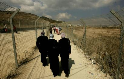 Palestinians passed through the Hawara checkpoint near Nablus in the West Bank. The Israeli Cabinet yesterday voted to release 90 Palestinian prisoners to shore up Palestinian President Mahmoud Abbas in his power struggle with Islamic Hamas militants.
