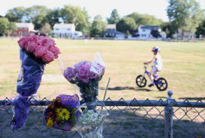 Flowers were placed on a fence next to the Winn Brook School's soccer field yesterday in memory of Maeve Goulding.