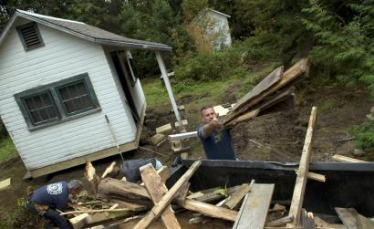 Ivan Menard of the Vermont National Guard, working on a summer cottage with Kurtis Mellett and Macneil, was unaware of government aid for small-business owners. He sold the equipment he used in his landscaping business when he was deployed to Afghanistan in 2003.