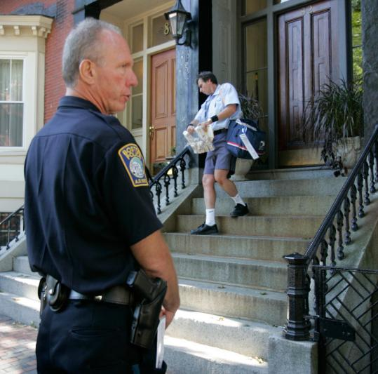 Frank Lee and other US postal workers delivered faux medication to homes in the South End and West Roxbury yesterday morning as part of a bioterror drill.