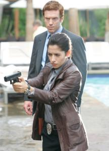 Damian Lewis (with Sarah Shahi) plays a cop out to avenge his setup.