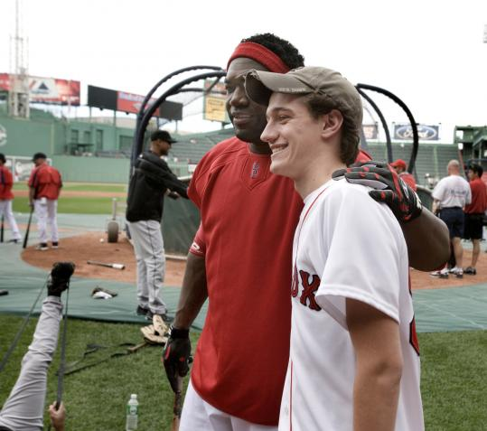 David Ortiz poses with Dan Prager of Brookline. 'I don't even think a religious experience comes close,' Prager said.
