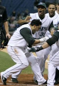 Dioner Navarro created a buzz with teammates with his walkoff homer in the 10th.