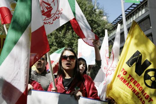 Iran's President Mahmoud Ahmadinejad sat with Foreign Minister Manouchehr Mottaki while Bush spoke.