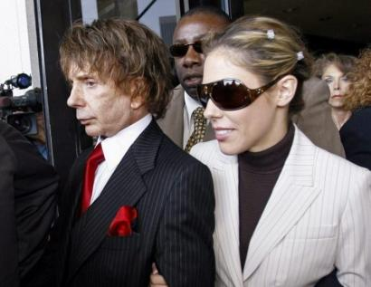 Phil Spector and his wife, Rachelle, left court in Los Angeles yesterday. The prosecutor's office says it will seek to retry him.