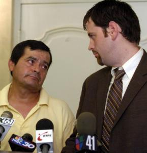 Juan Barrera (left), shown at a press conference, was arrested during a sting targeting day laborers.