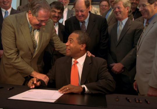 Representative Robert DeLeo (left) and Governor Deval Patrick yesterday at a bill signing in Marlborough.