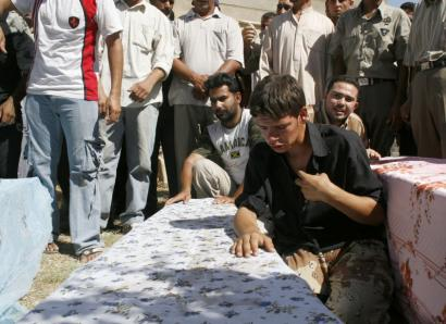 Mourners with three coffins yesterday in Dora, Iraq, after a US air strike targeted members of Al Qaeda. A Tunisian linked to the killings last year of American soldiers was one of the dead.