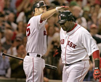 His 35th homer of the year - a solo shot in the eighth - earned David Ortiz a pat on the head from Mike Lowell. Ortiz went 3 for 4, rapping a double to go with his homer. Lowell was 2 for 4.