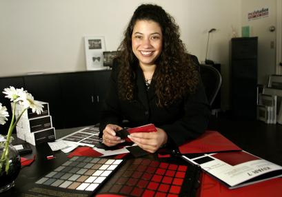 Marlisa Clapp of MCD Studios in Marshfield is designing new business cards to replace her current cards.