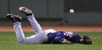 Twins center fielder Torri Hunter can't reach this base hit by Mike Lowell in the seventh inning. Lowell went 2 for 4 with two RBIs.