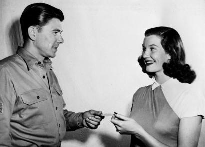 Lois Maxwell received her Screen Actors Guild card from Ronald Reagan, then new guild president.