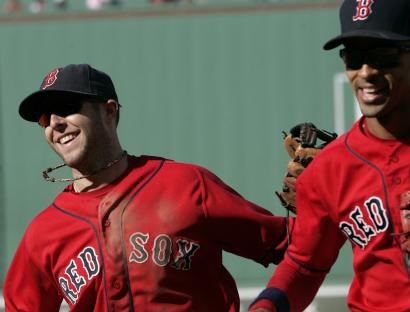 Dustin Pedroia likes to keep it loose, as he did Sunday giving Julio Lugo a slap on the back.