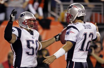Linebacker Mike Vrabel celebrates with Tom Brady after making his ninth career TD catch.