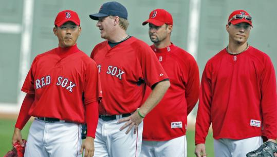 Tim Wakefield (second from right) won't be available to lend a hand to fellow Sox starters Daisuke Matsuzaka, Curt Schilling, and Josh Beckett in the first-round series against the Angels.